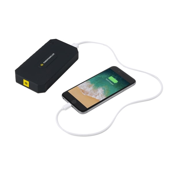 A power bank charging a phone